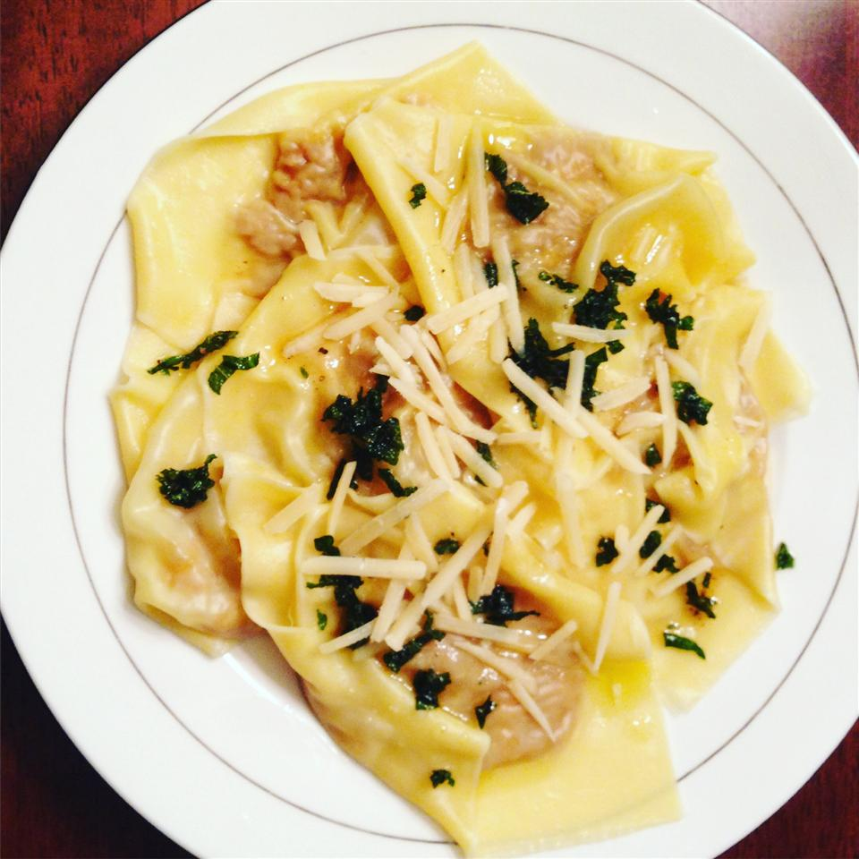 plate of butternut squash ravioli with sage-brown butter sauce
