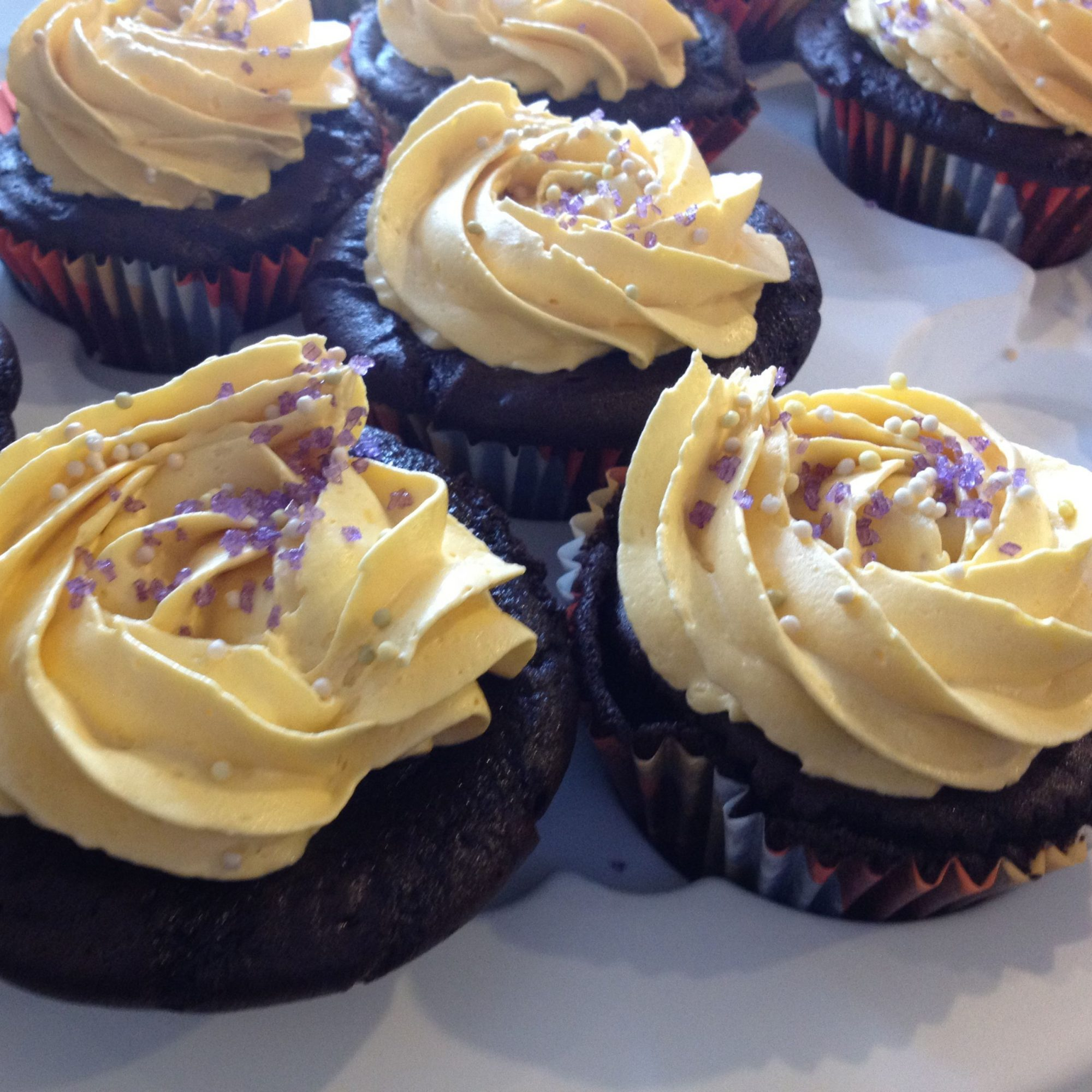 Vegan Chocolate Cupcakes with Vanilla Frosting on a white plate