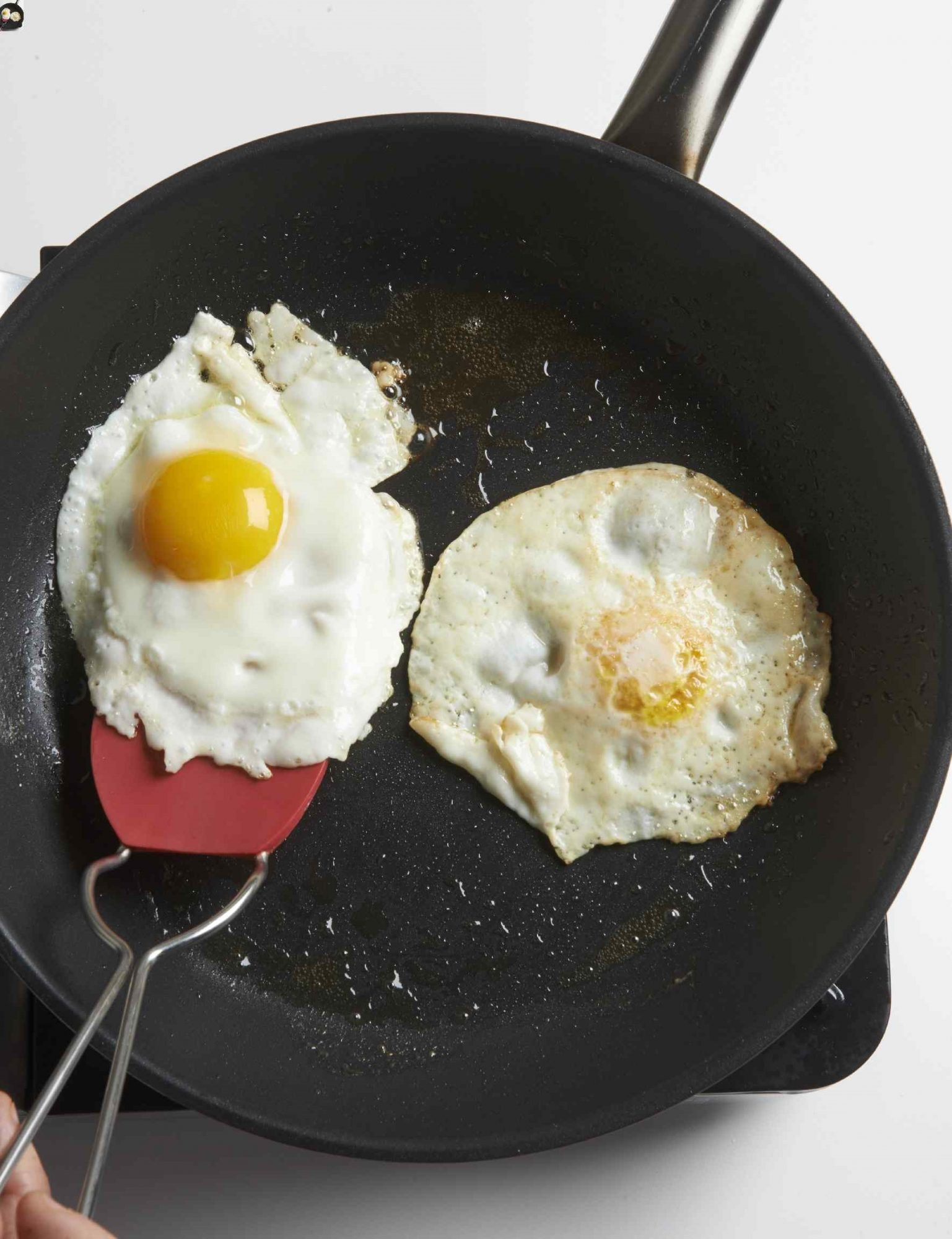 two fried eggs in a skillet