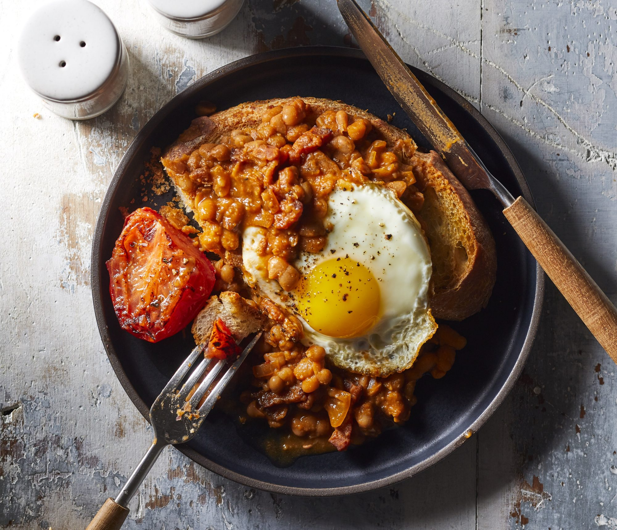 Baked beans and toast with an egg on top