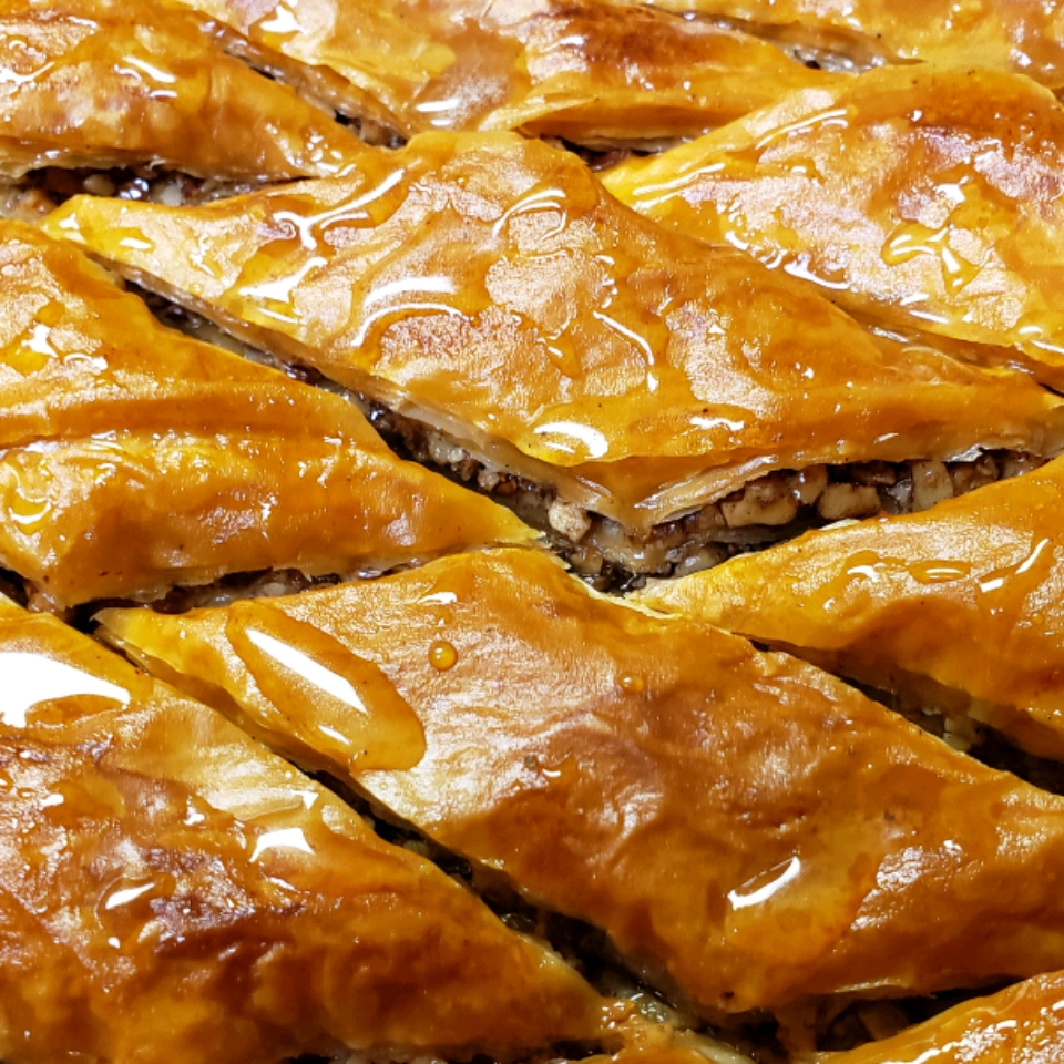 A tray of baklava with crispy layers of phyllo