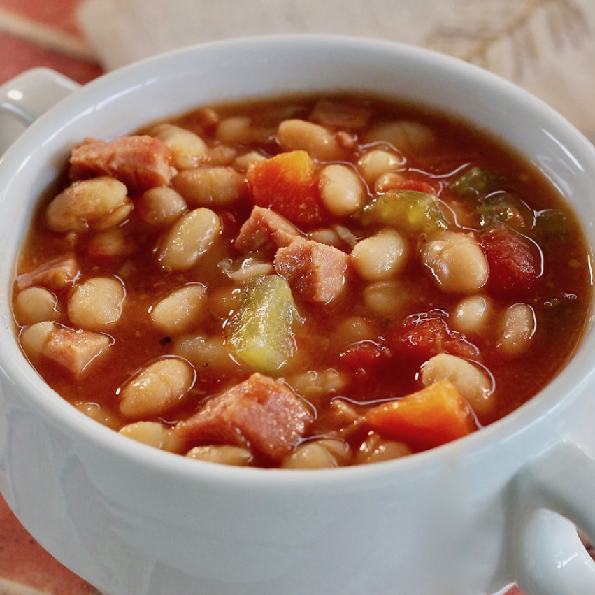A bowl of bean and ham soup