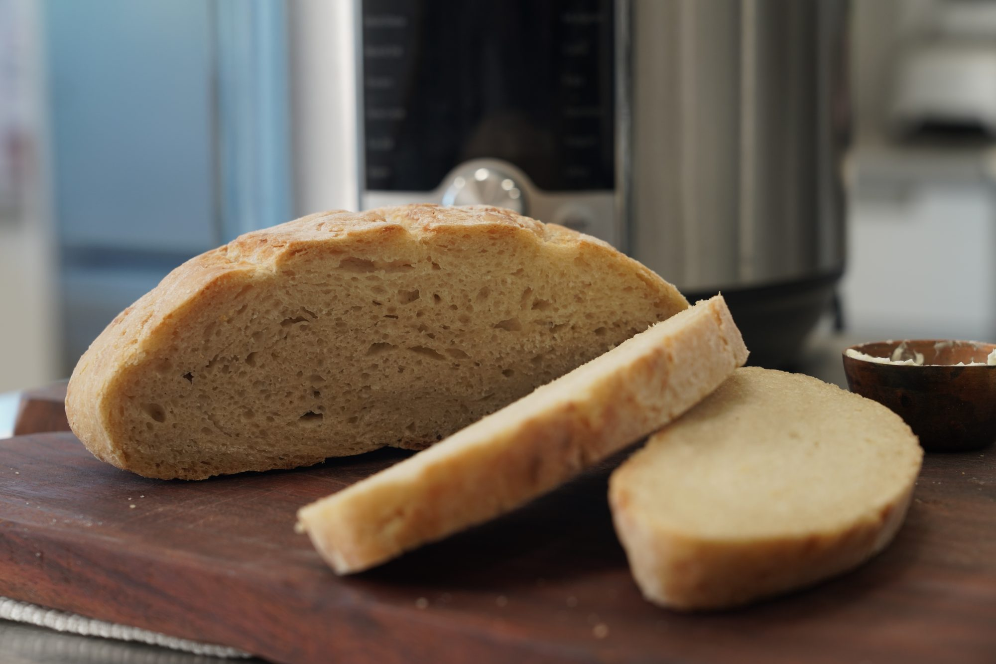 sliced loaf of instant pot crusty no-knead bread