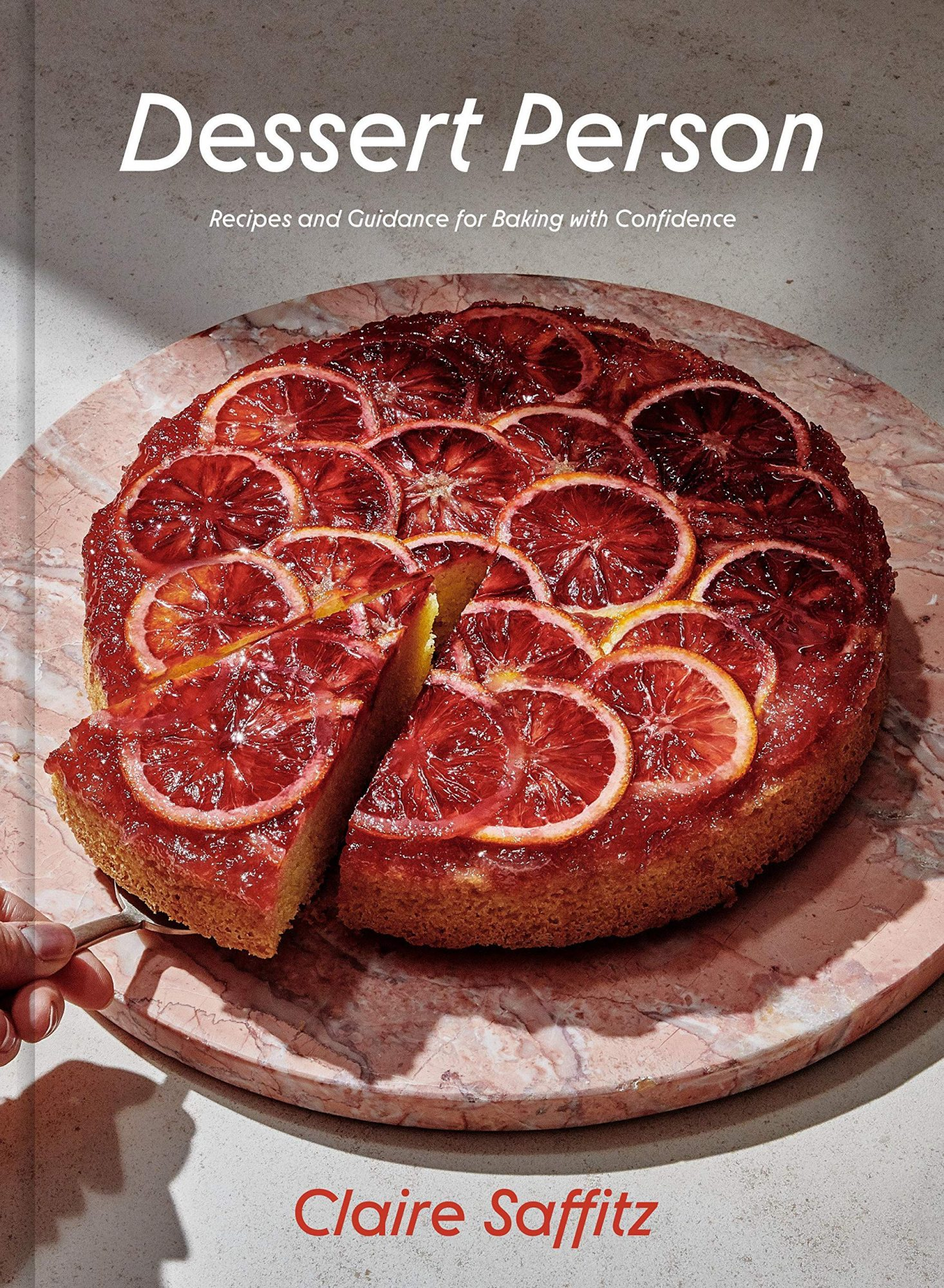 Cookbook cover with grapefruit tart photo on it