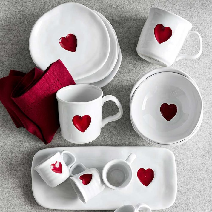 white ceramic dinnerware with red heart stamps
