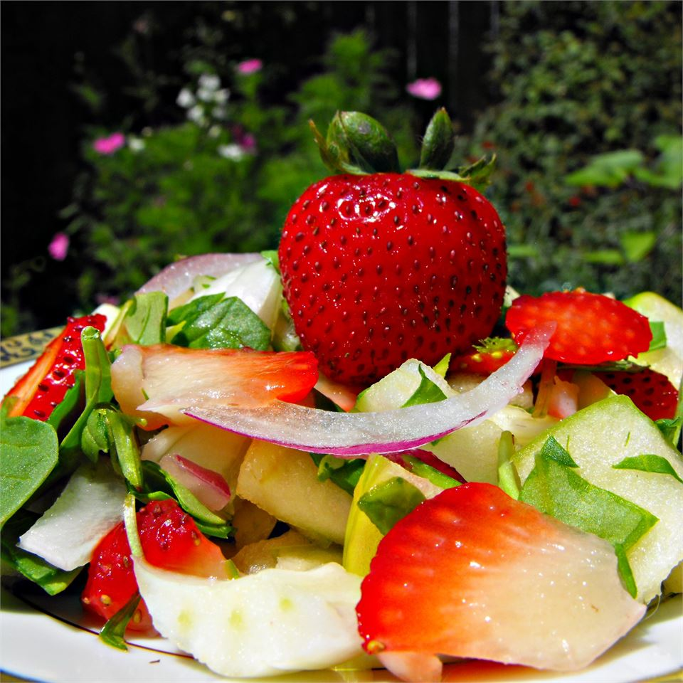 Spring Strawberry Spinach Salad on a white plate