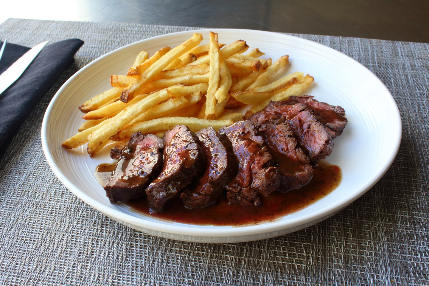 Butcher's Steak on a plate with fries