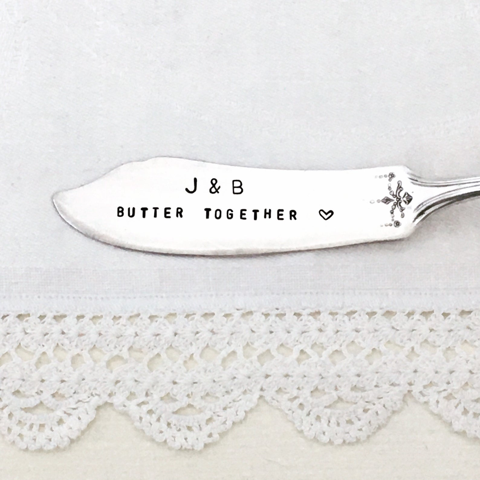 "butter knife engraved with ""J & B Butter Together"""