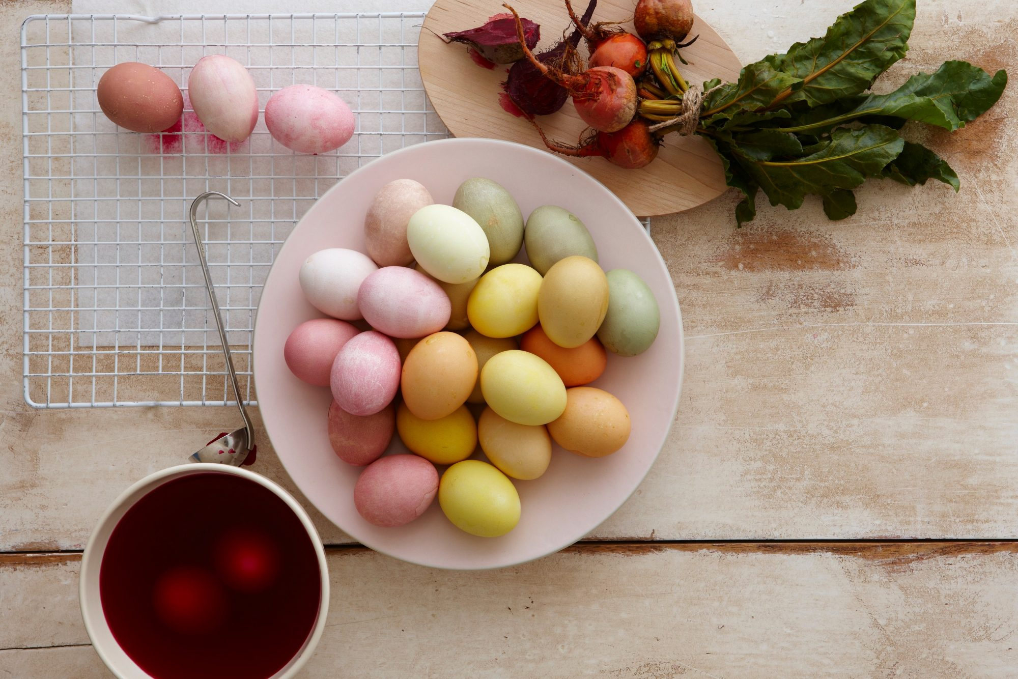 bowl of Easter eggs dyed with various natural dyes made from plants