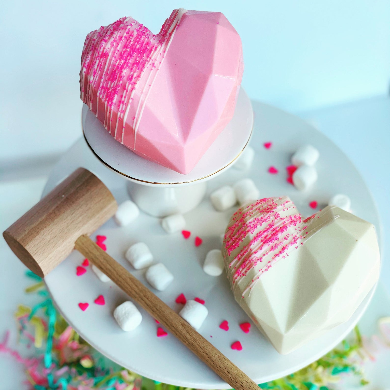 pink and white chocolate hearts with a hammer to smash them open
