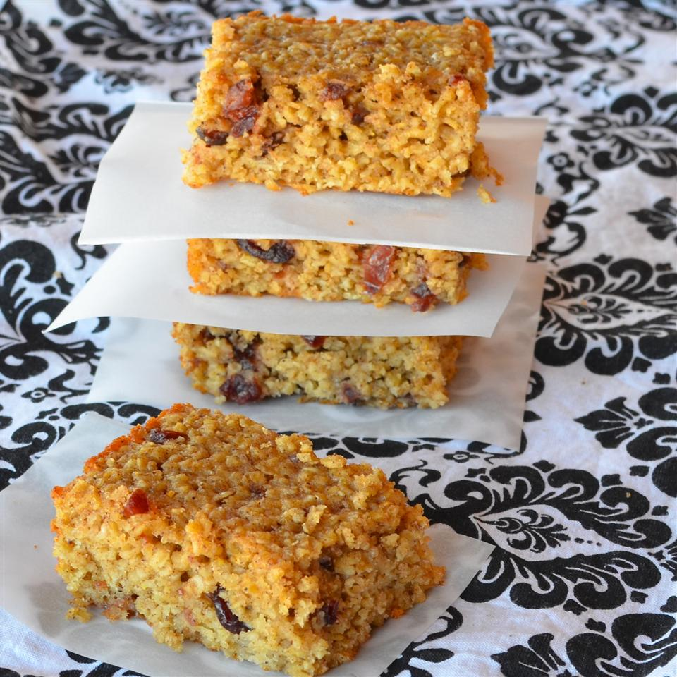 stack of sliced oatmeal breakfast bars on parchment paper