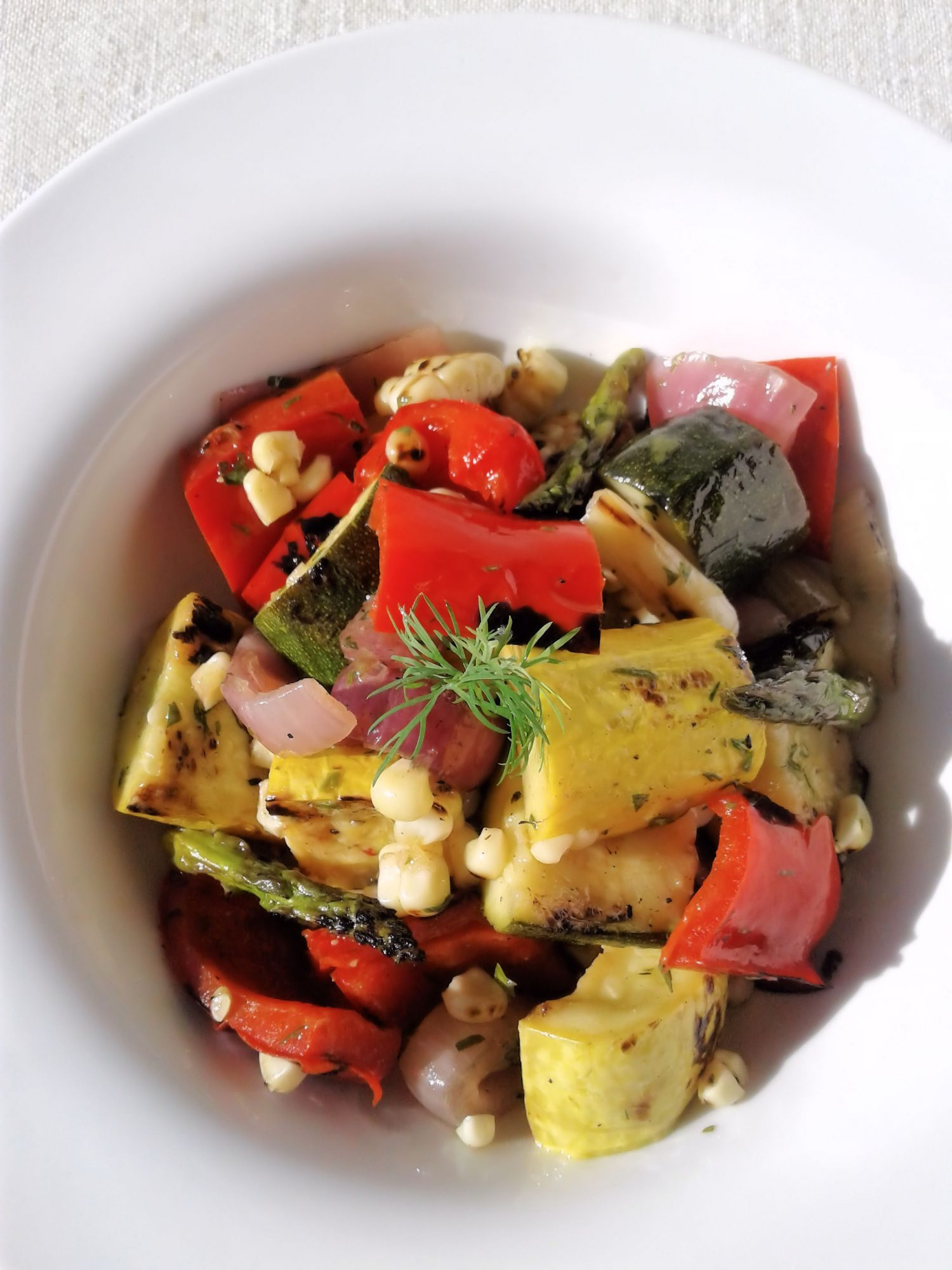 grilled vegetables in white bowl