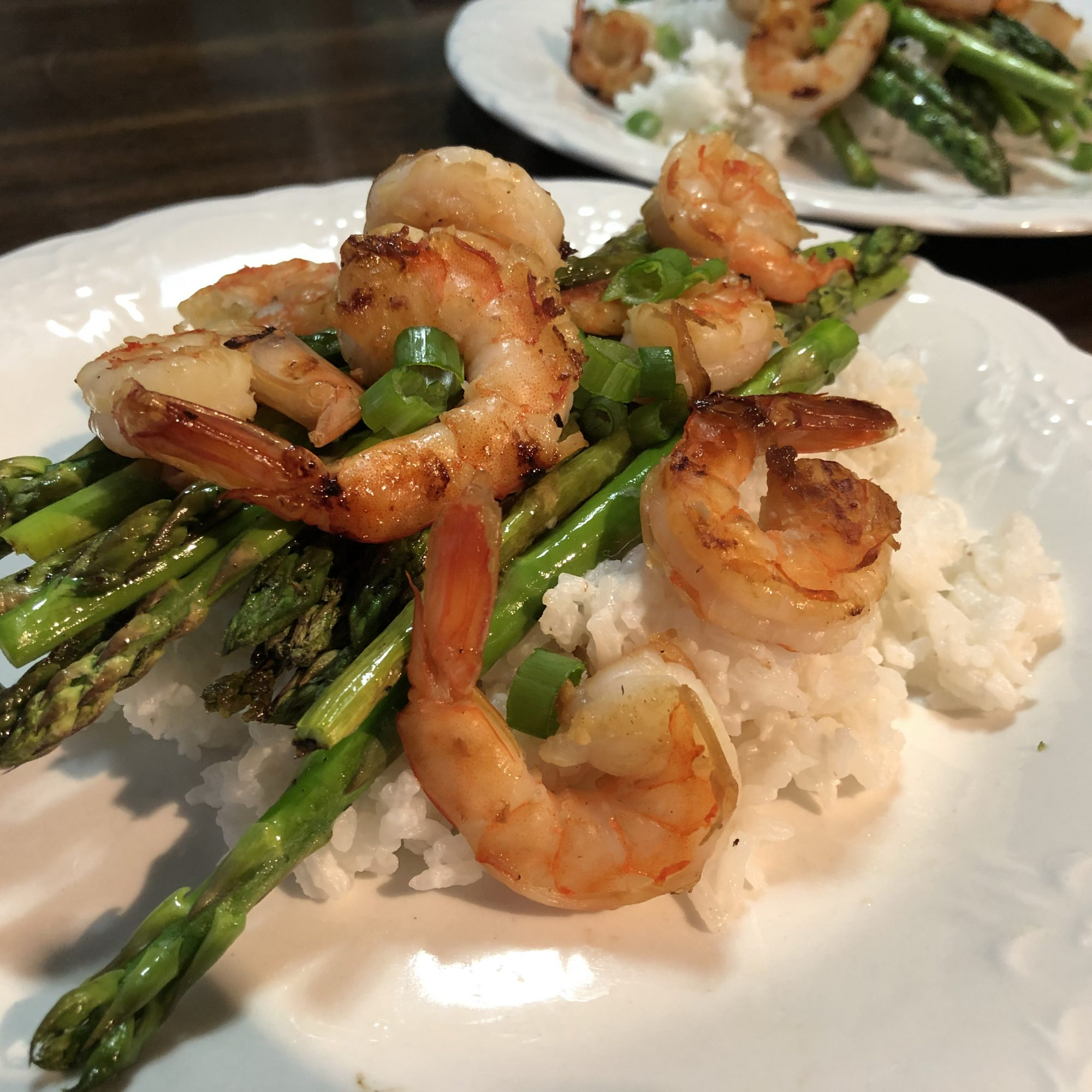 grilled teriyaki shrimp with asparagus over bed of white rice