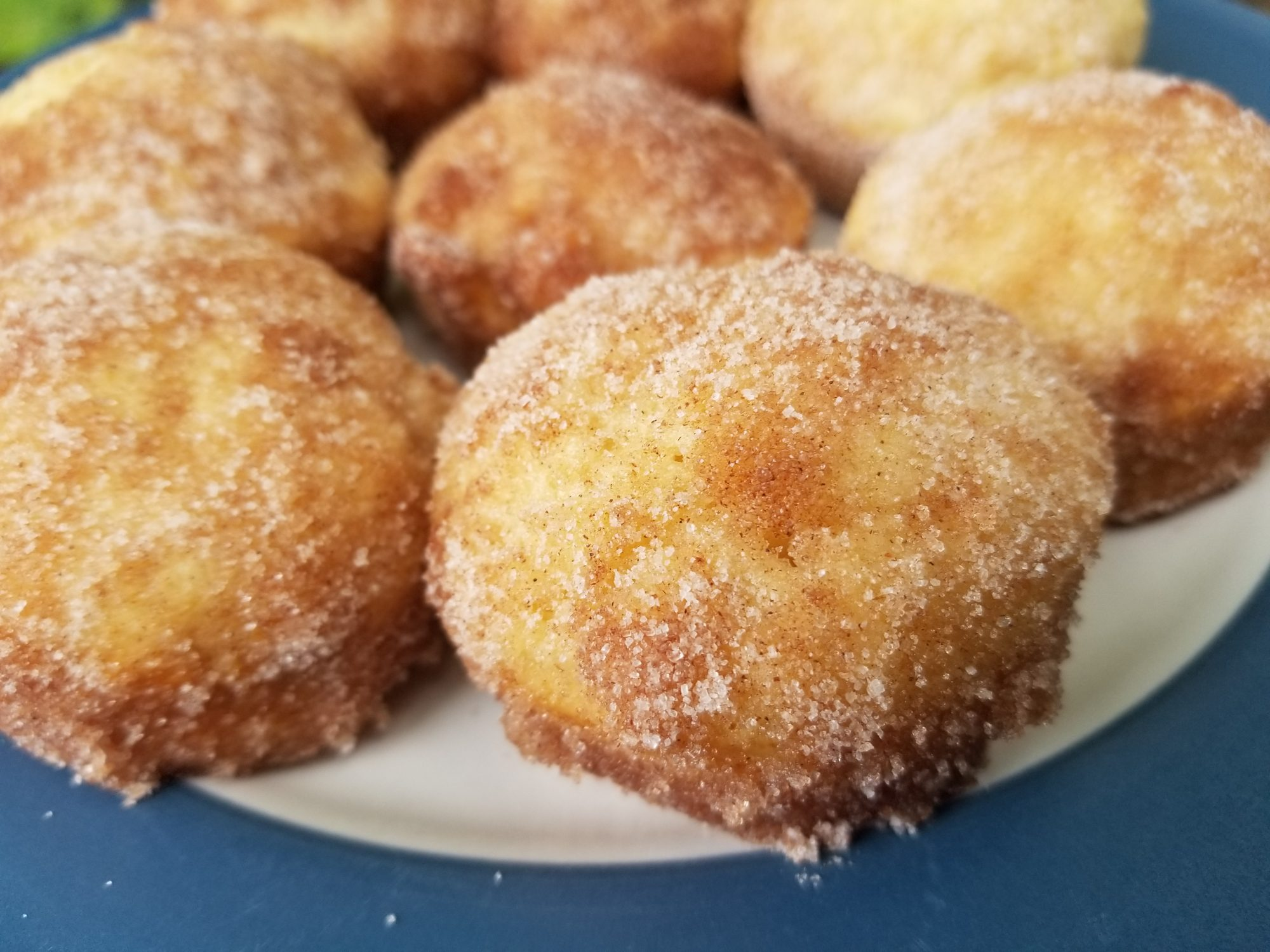plate of french breakfast puffs dusted with cinnamon sugar