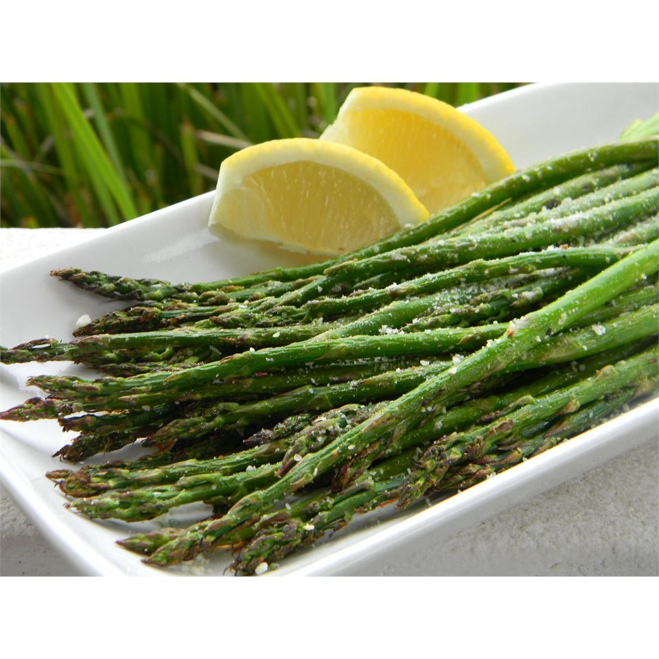 grilled asparagus with parmesan and lemon wedge