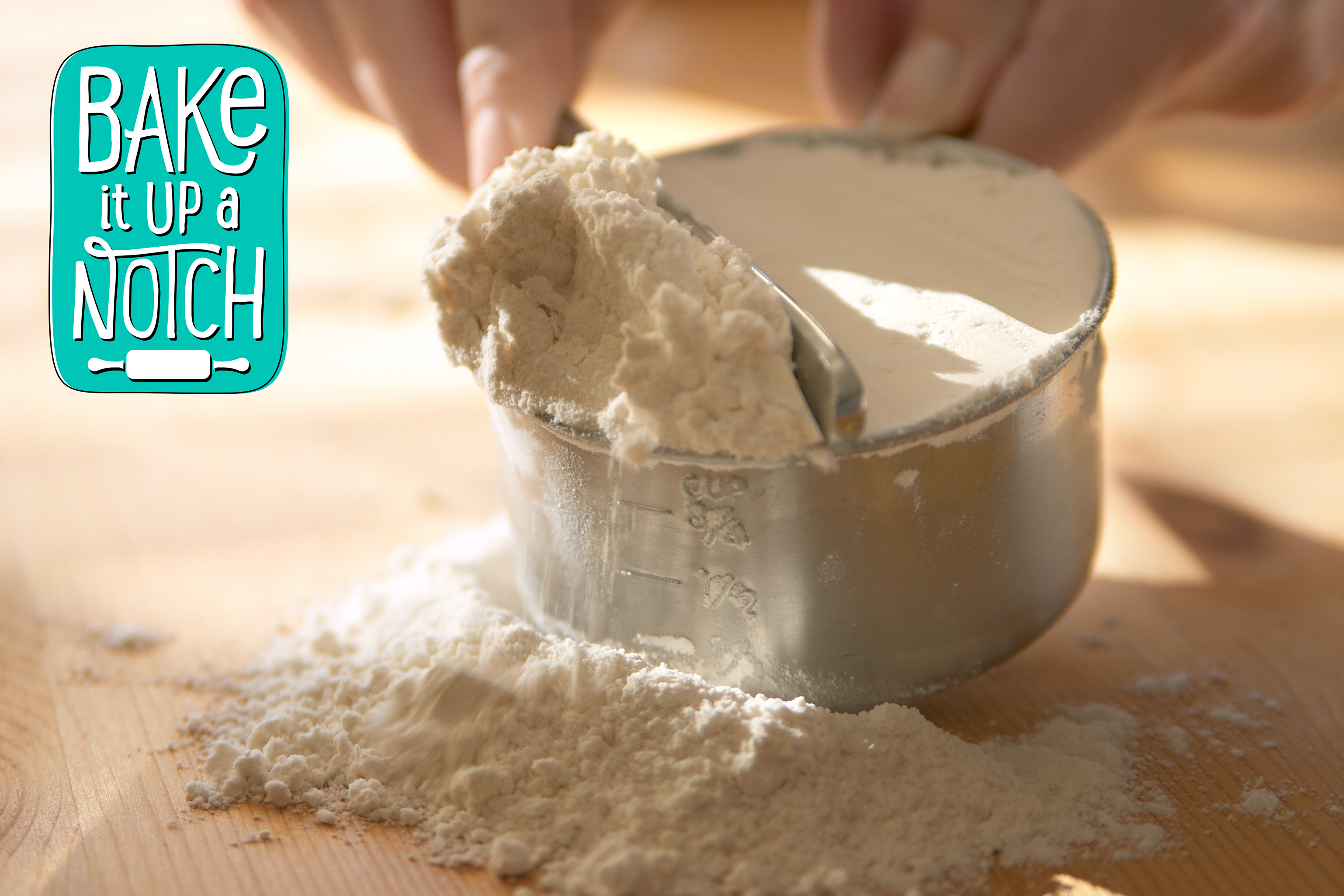 leveling flour in measuring cup