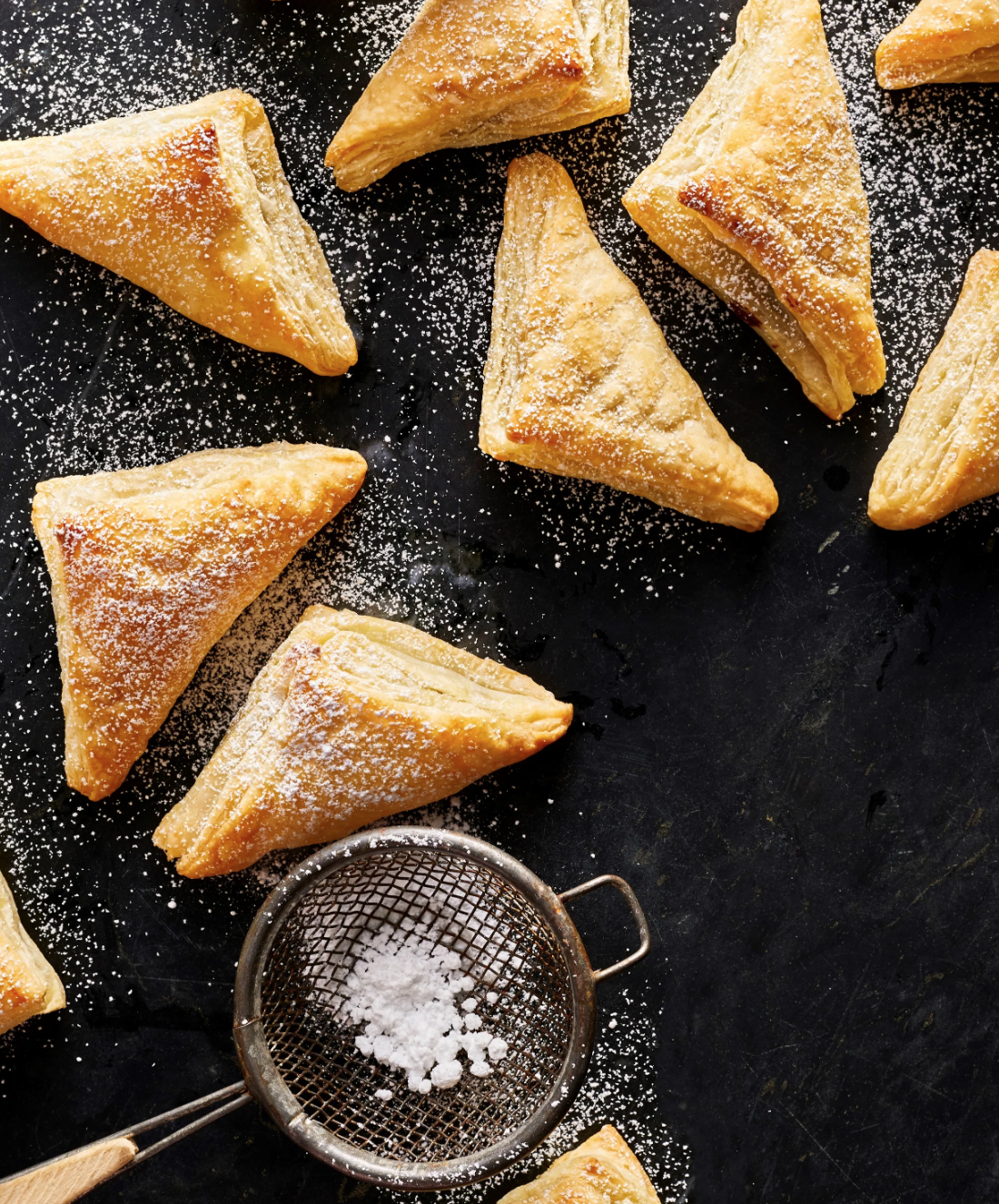You only need five ingredients to make this easy handheld dessert: frozen puff pastry, chocolate-hazelnut spread, chopped hazelnuts, an egg, and a bit of water.