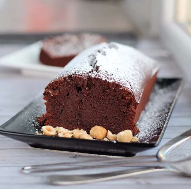 You need just seven ingredients to make this delicious cake: margarine, white sugar, eggs, flour, cornstarch, ground hazelnuts, and unsweetened cocoa powder.