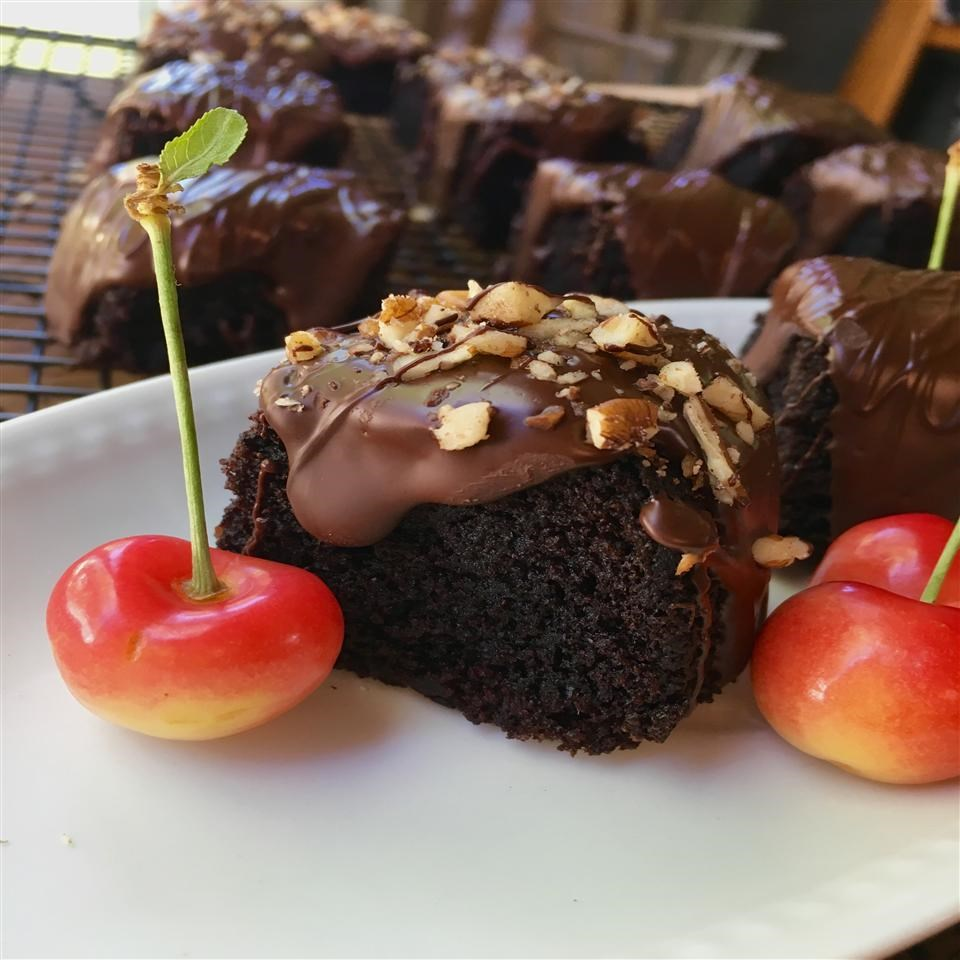 slices of chocolate cake with chocolate frosting