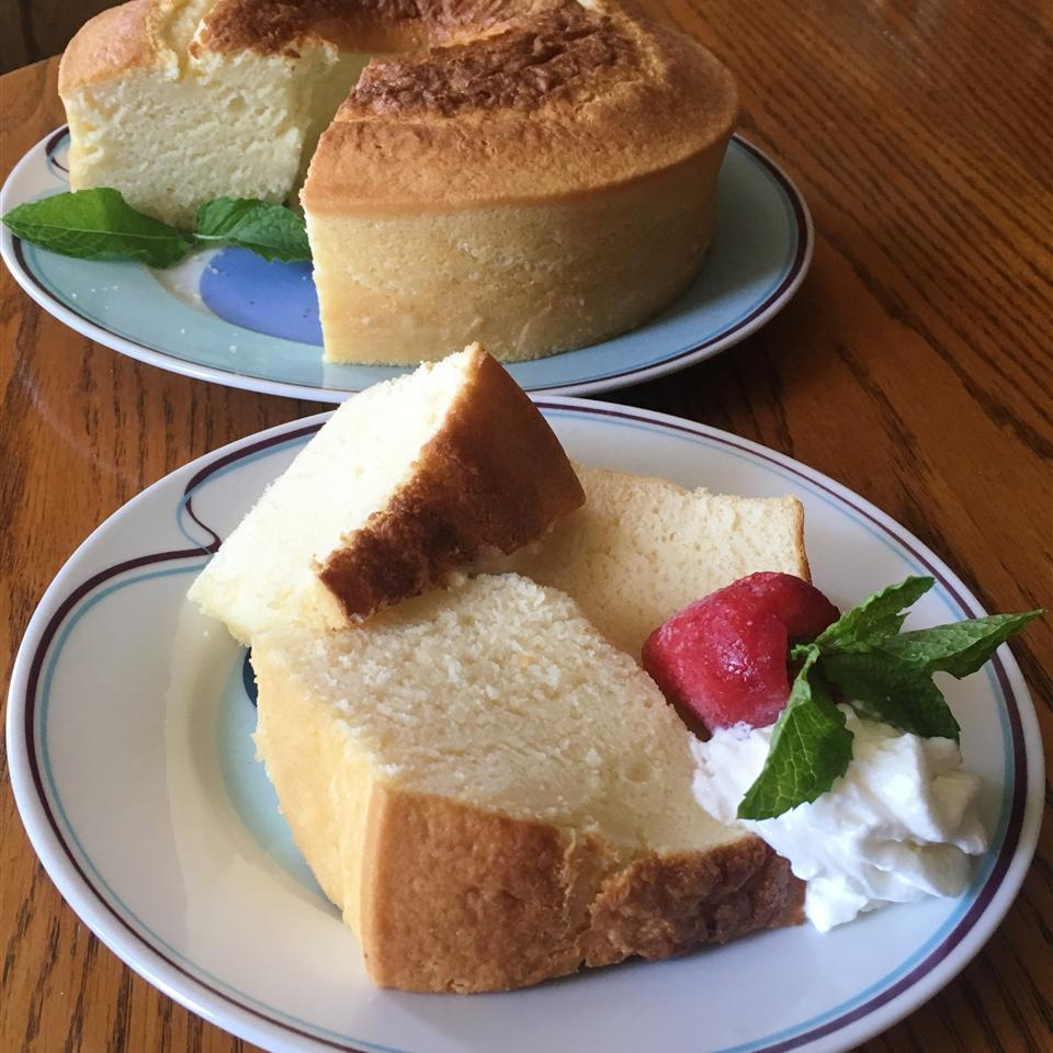 slice of milk cake in front of whole cake
