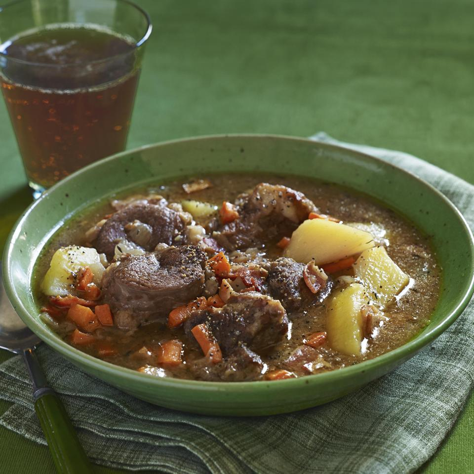 Irish Stew with lamb, potatoes, and carrots in green bowl