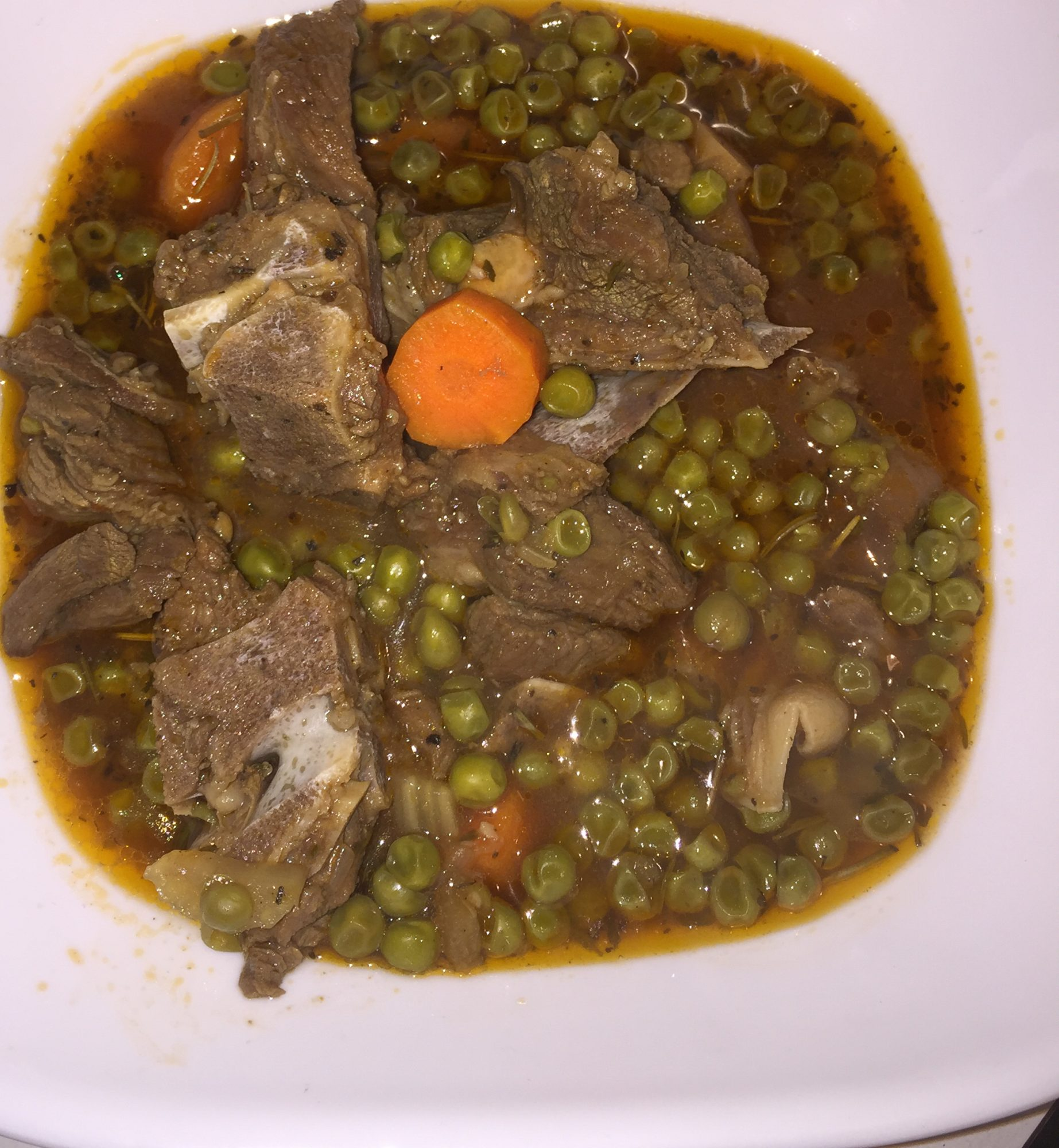 lamb stew with green peas and carrots