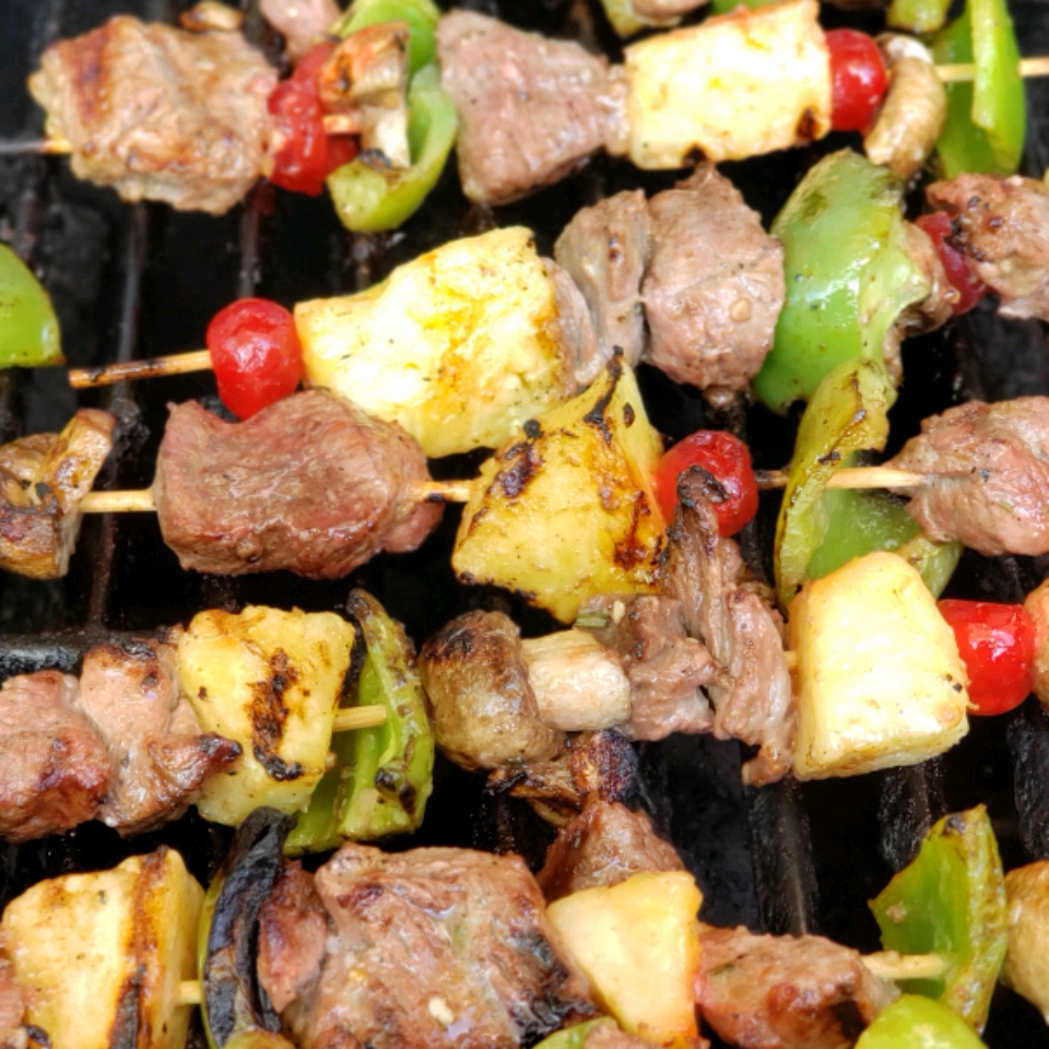 lamb kabobs with pineapple, bell peppers, and tomatoes