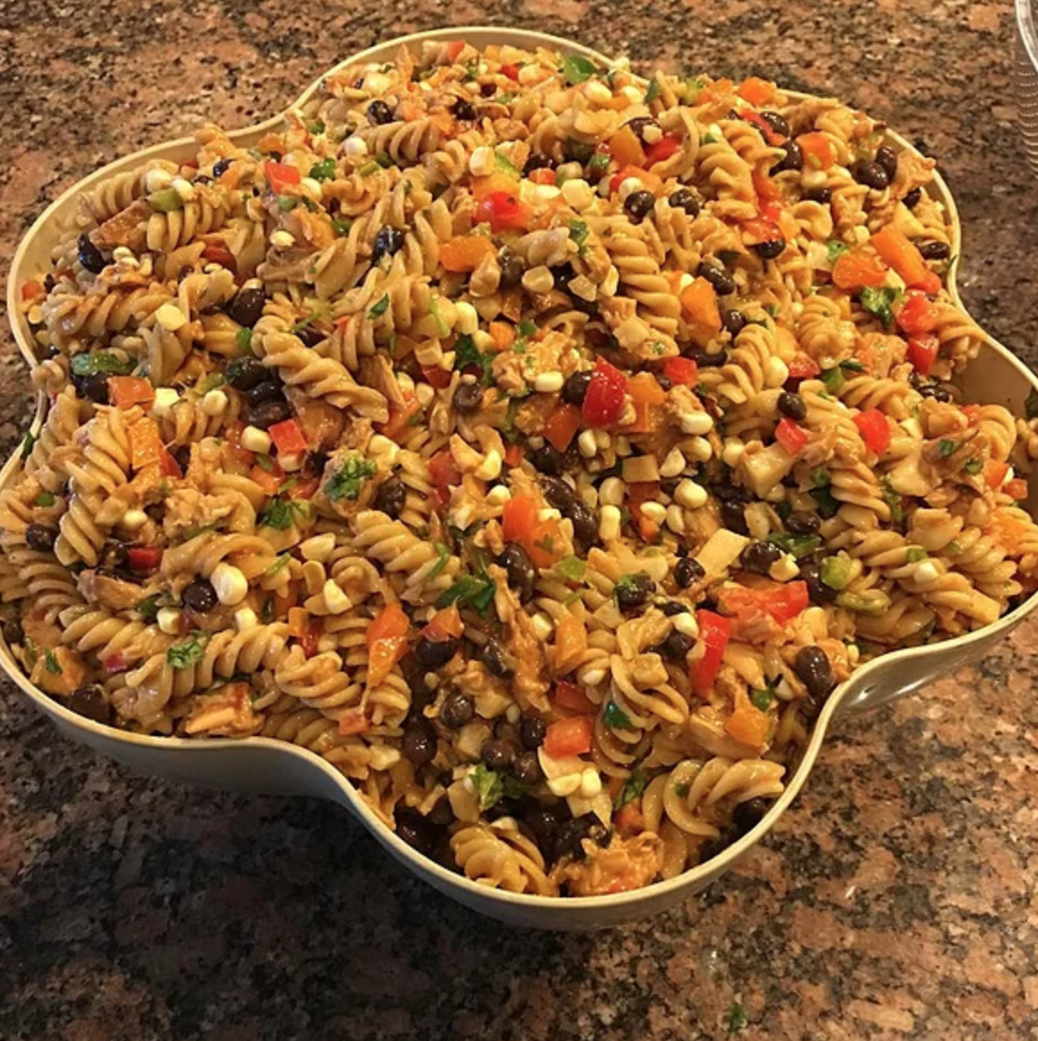 If you like barbecue chicken, you'll love this zesty pasta salad. Use a bottle of your favorite store-bought barbecue sauce or make some homemade sauce with this top-rate recipe.