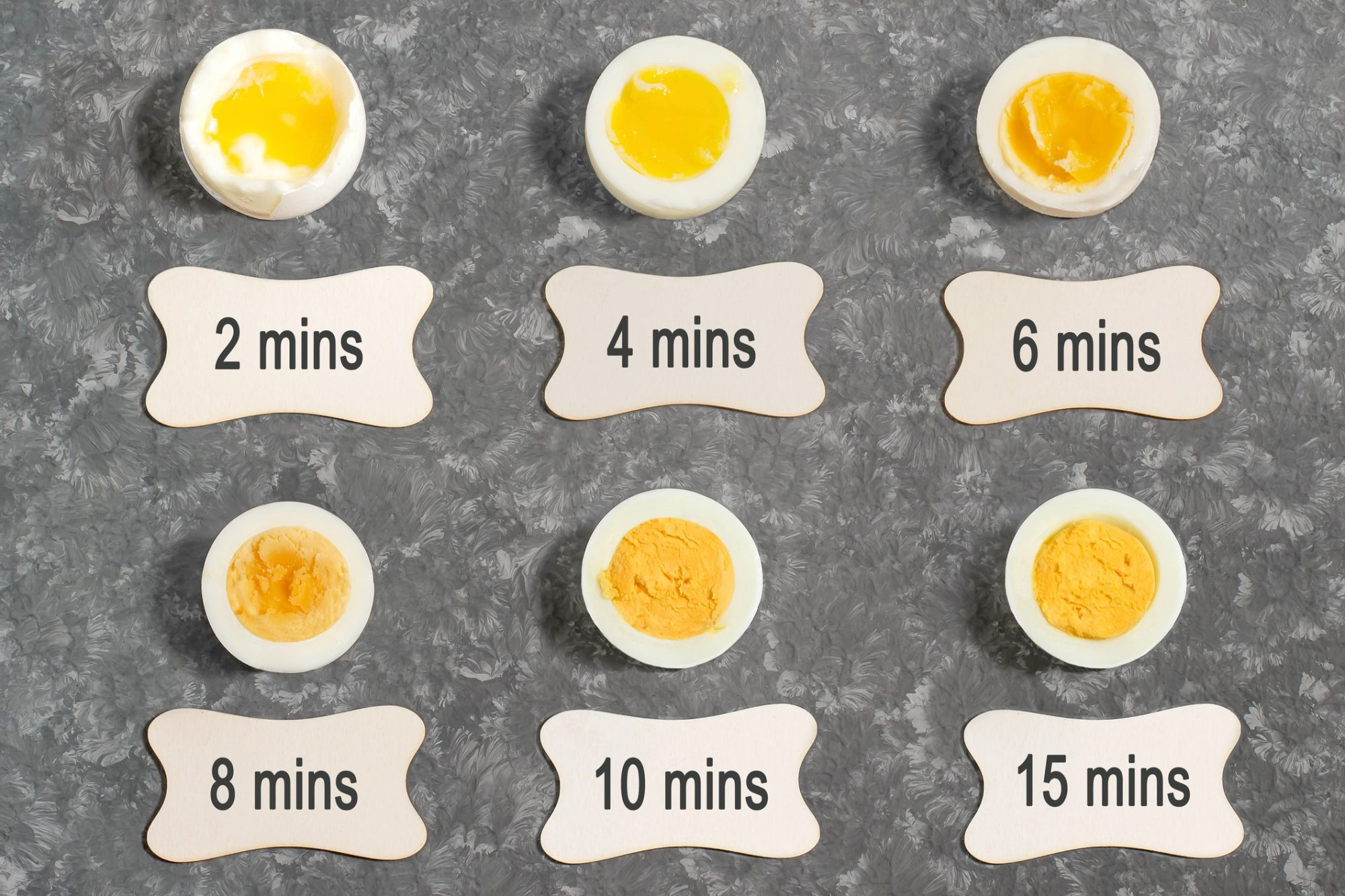 boiled eggs at different cook times from 2 minutes to 15 minutes