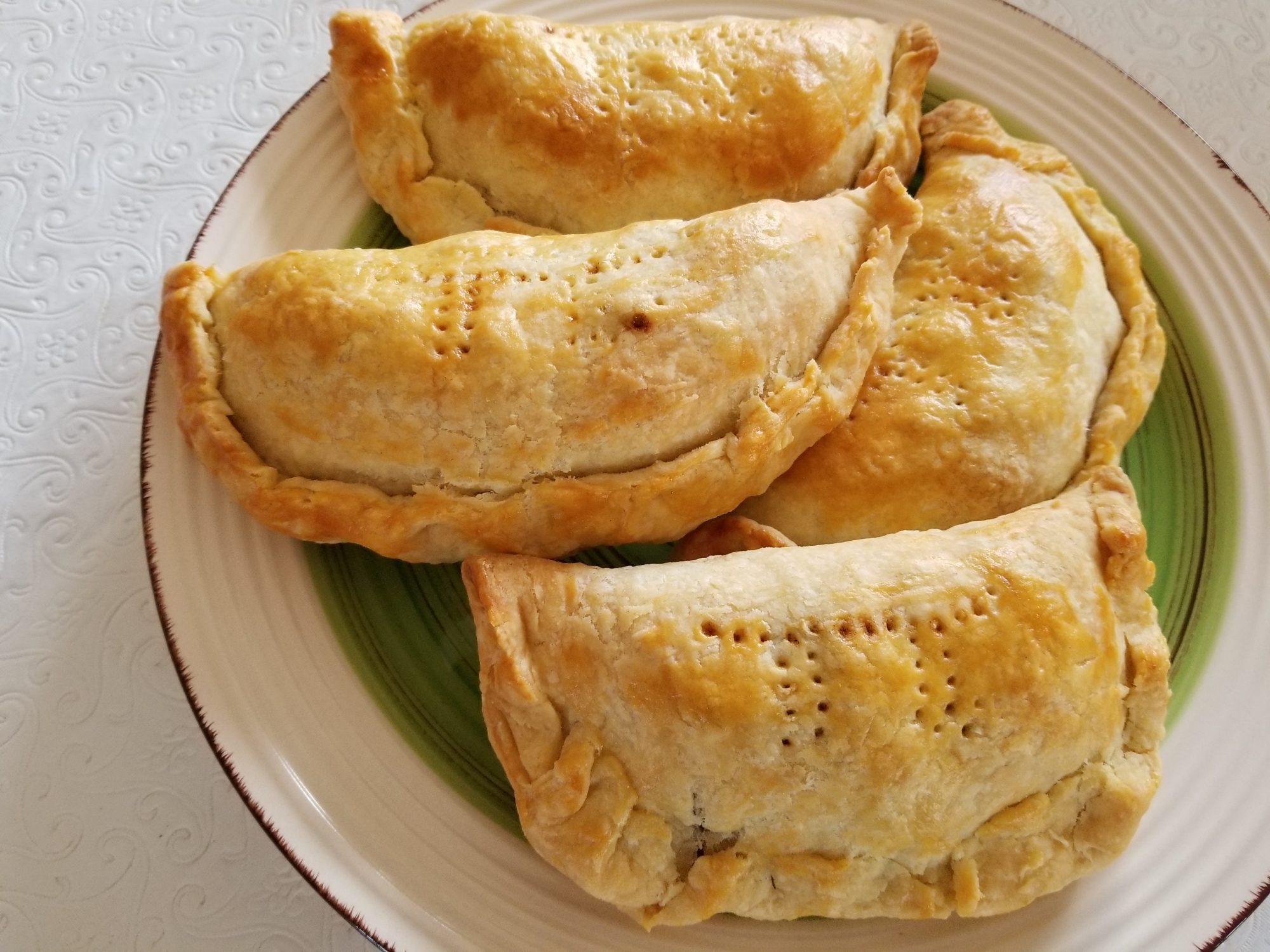 Apple Hand Pies on a green and white plate