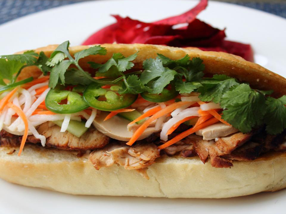Roasted Pork Banh Mi on a white plate