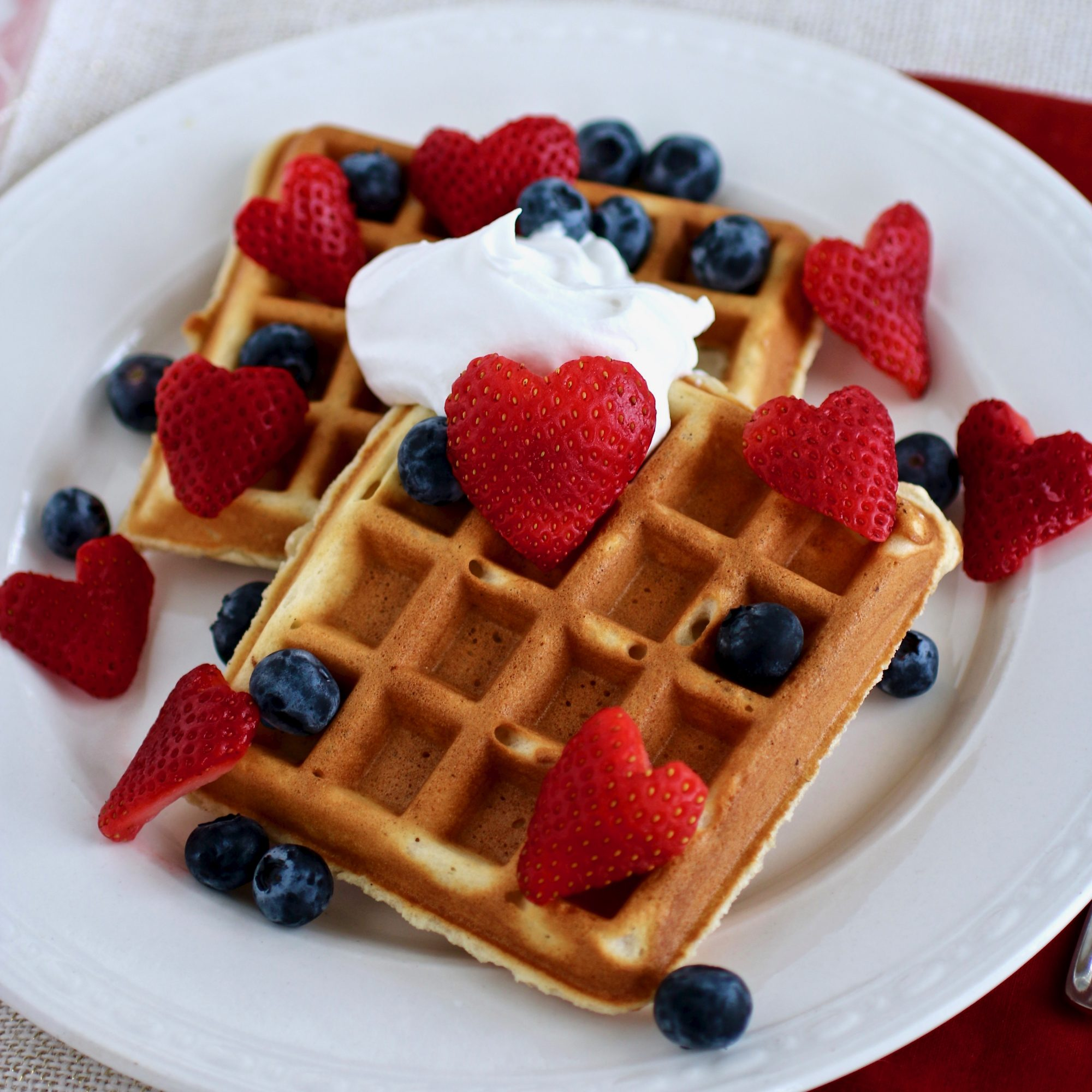 Classic Waffles topped with fresh strawberries, blueberries, and whipped cream