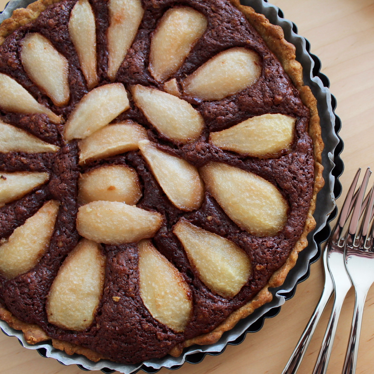 overhead view of pear and chocolate tart