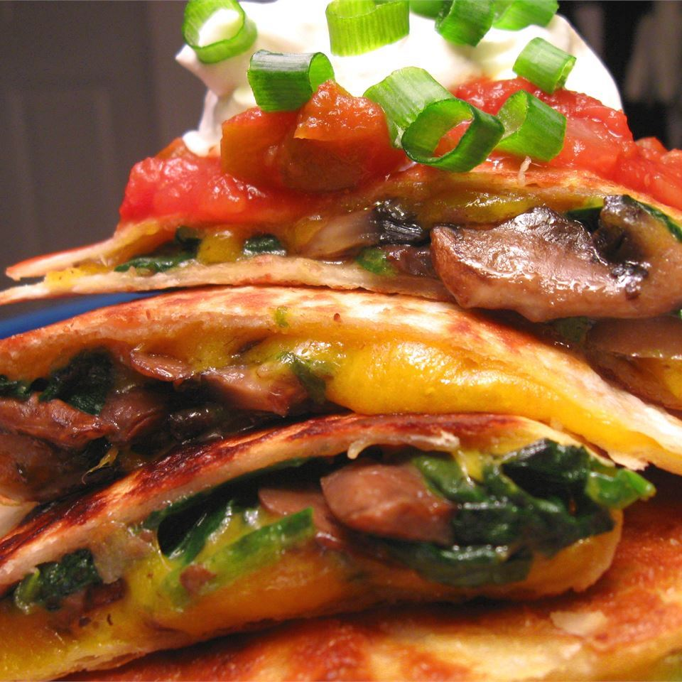 stack of quesadillas with spinach and mushrooms
