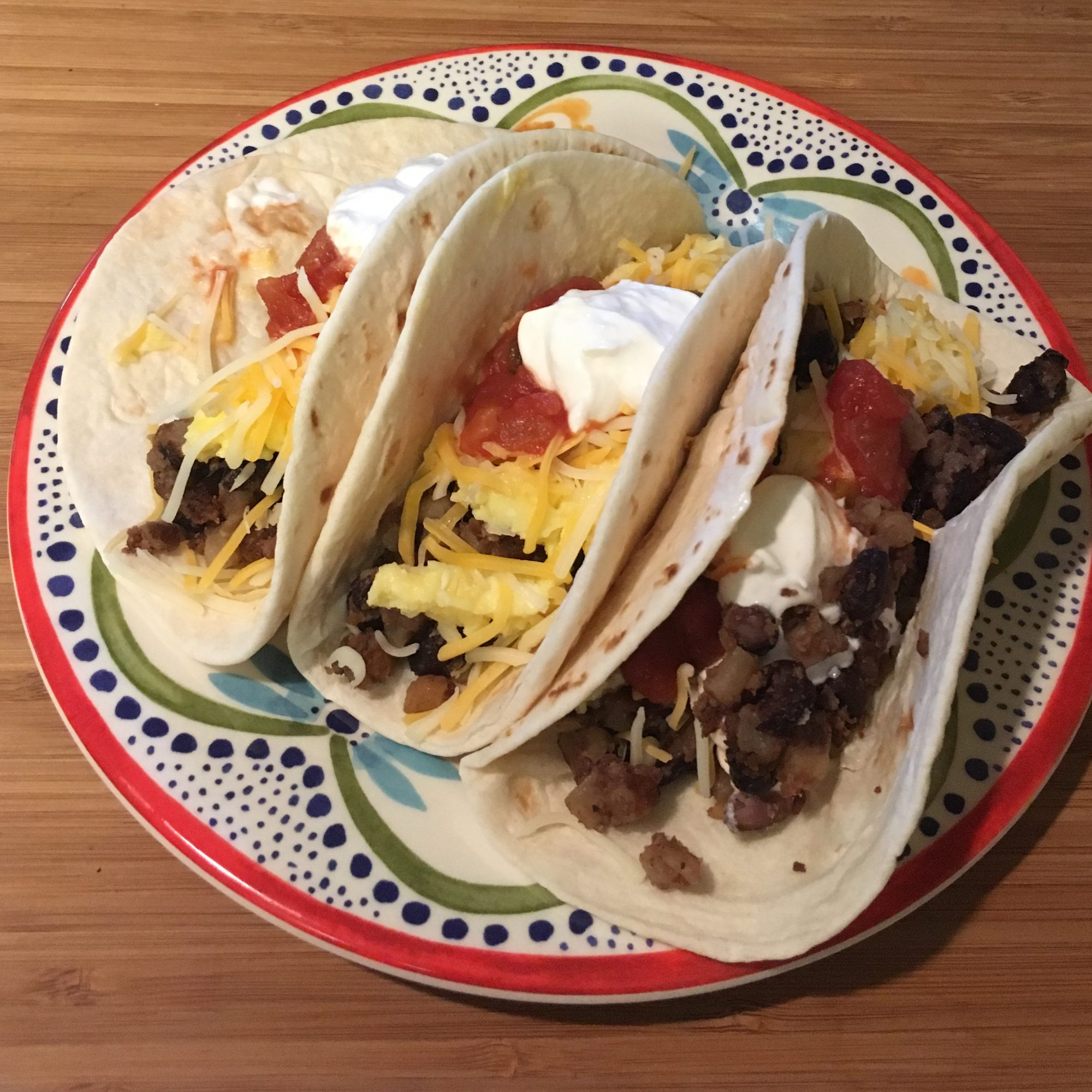corned beef hash breakfast tacos on a plate