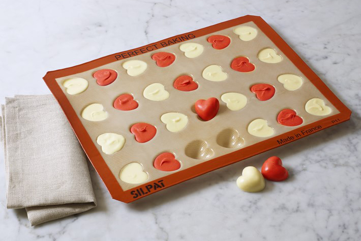 Silpat Heart Mold with red and white chocolate hearts in the molds