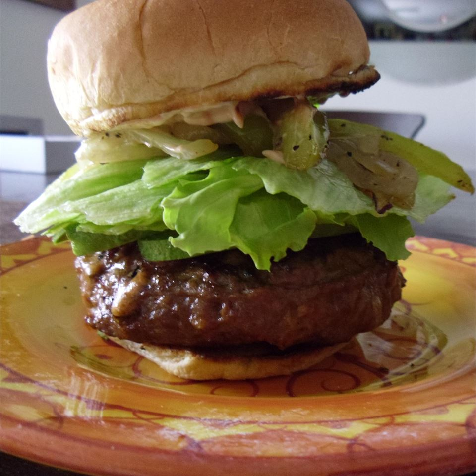 burger on bun with lettuce and pickles