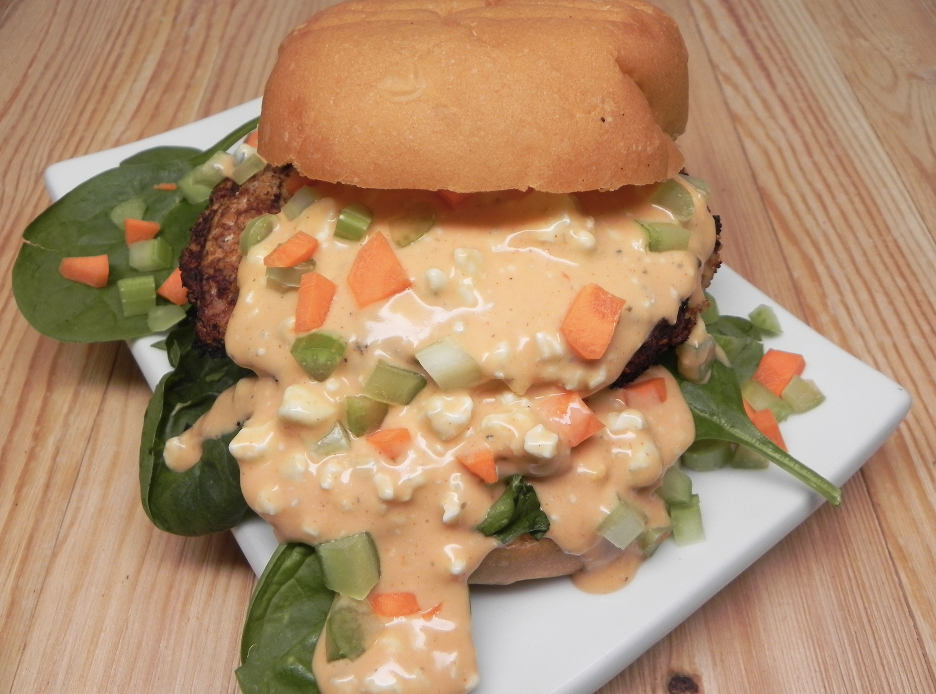 stuffed burger with buffalo sauce and peppers