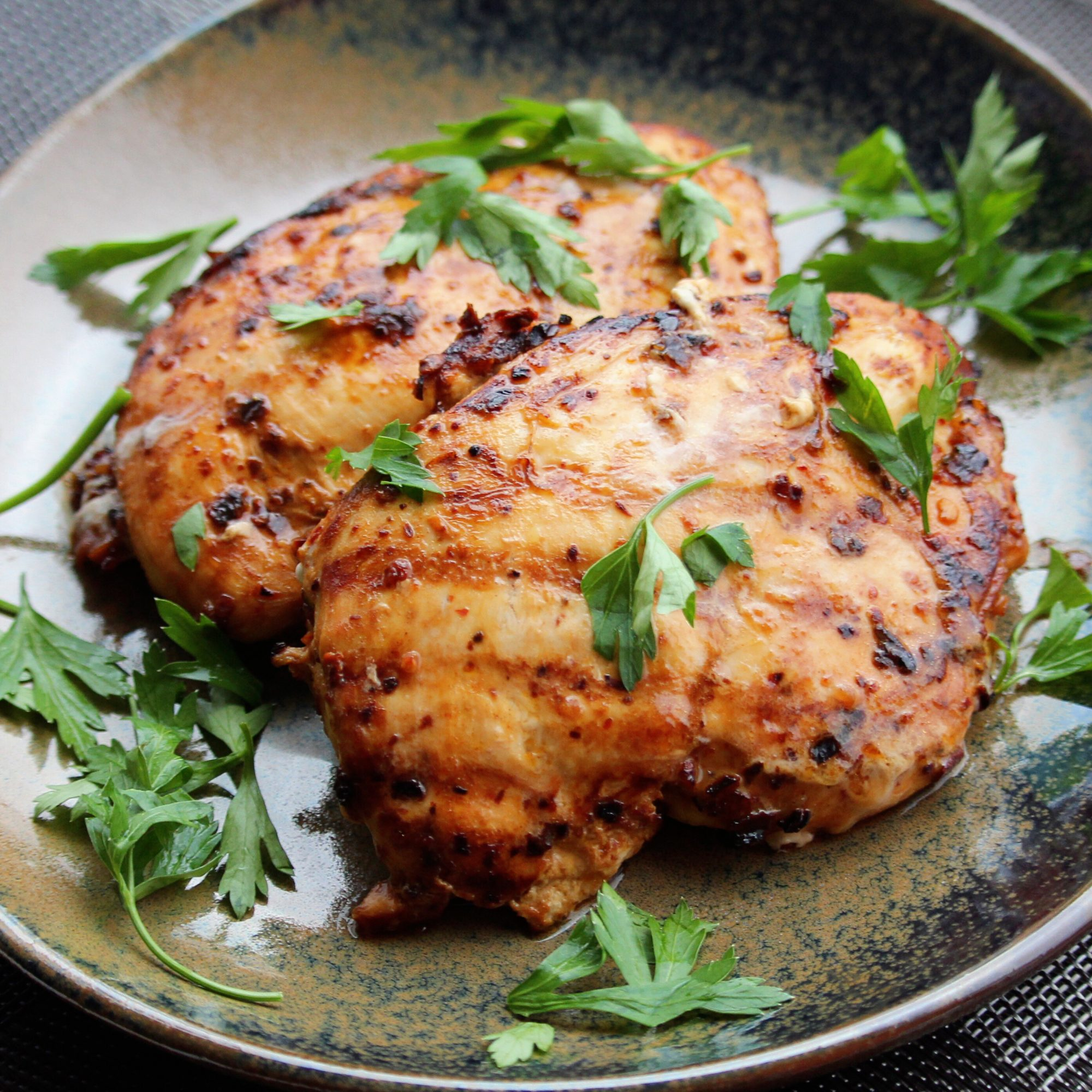 chicken thighs with chipotle seasoning and herb garnish