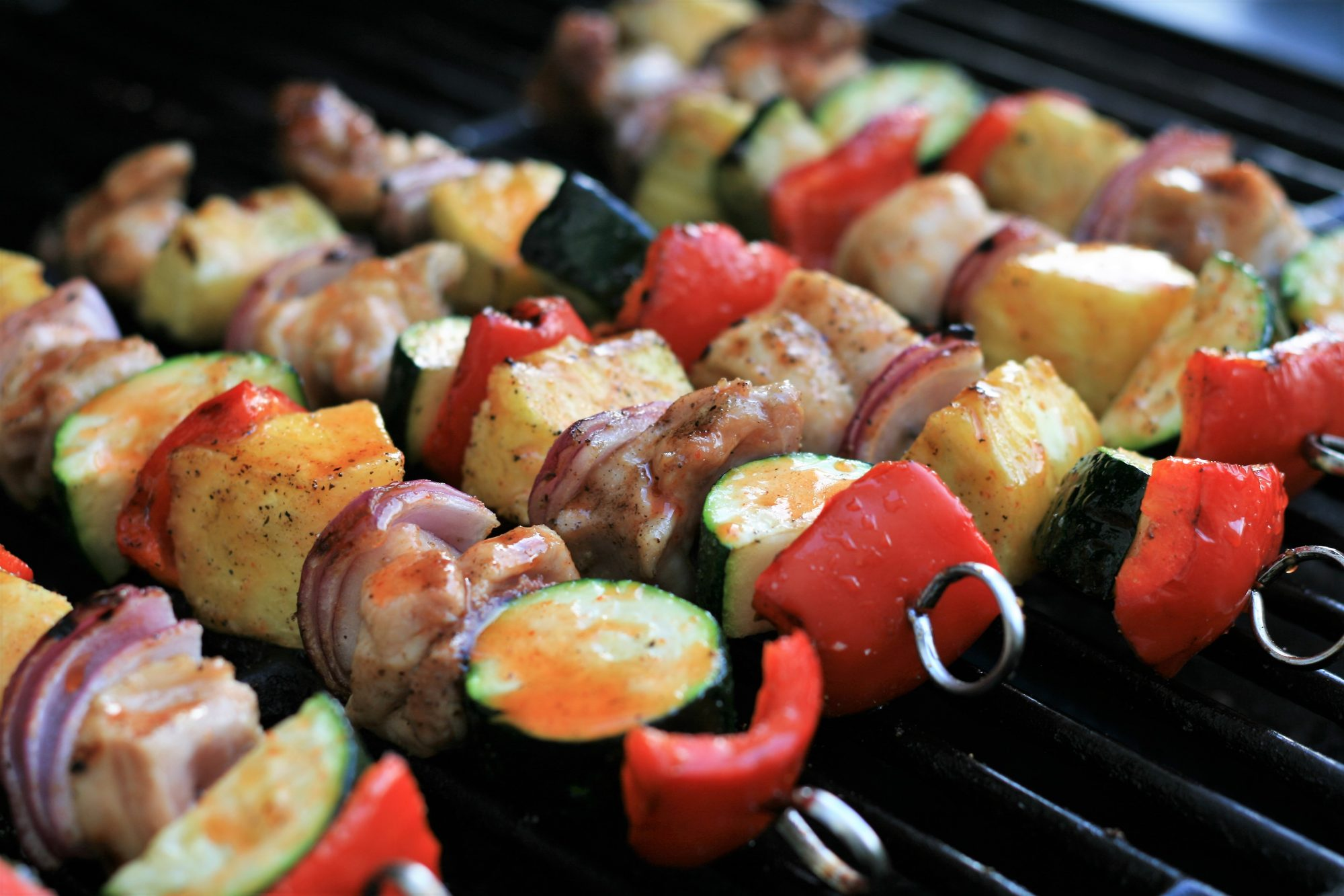grilled chicken and vegetable kabobos on grill