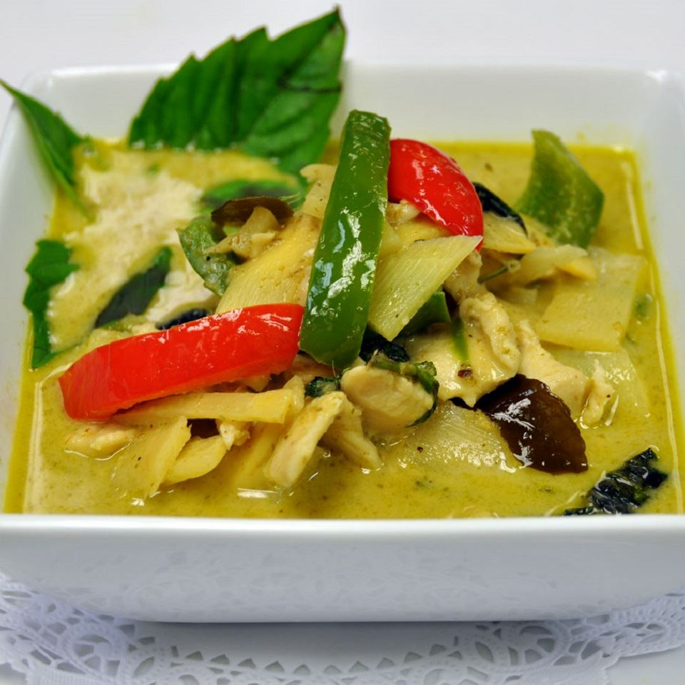 Thai Green Curry with Chicken in a white bowl