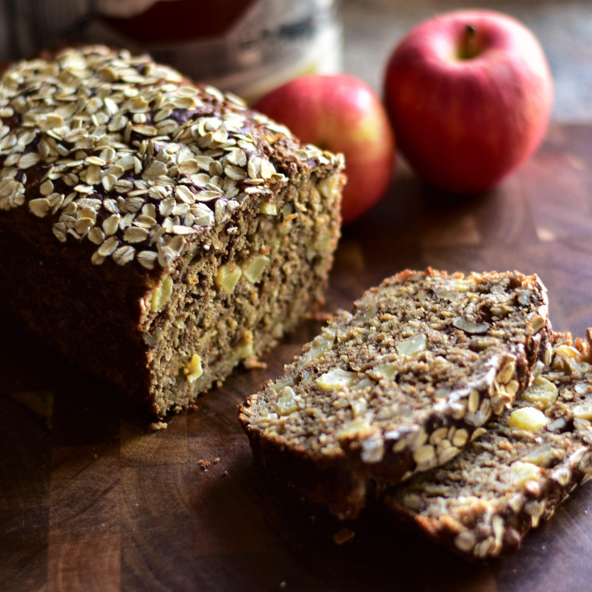 Maple and Apple Cider Oatmeal Bread on a wooden table