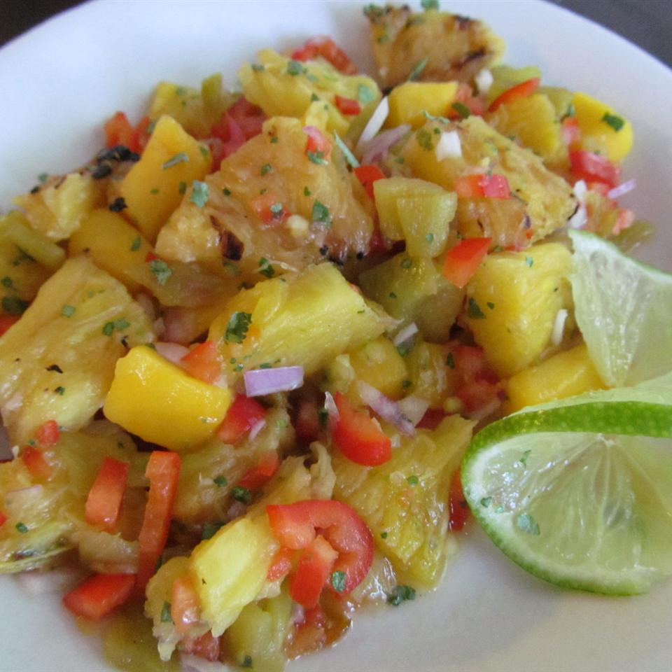 grilled mango and pineapple salsa with lime slices
