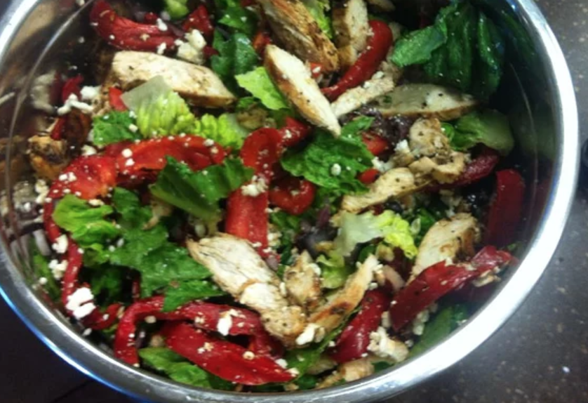 """""""Tender, boneless chicken breasts are marinated in sun dried tomato dressing, grilled with sweet bell peppers, and served atop a crunchy romaine bed sprinkled with feta and olives,"""" says recipe creator Marjory."""