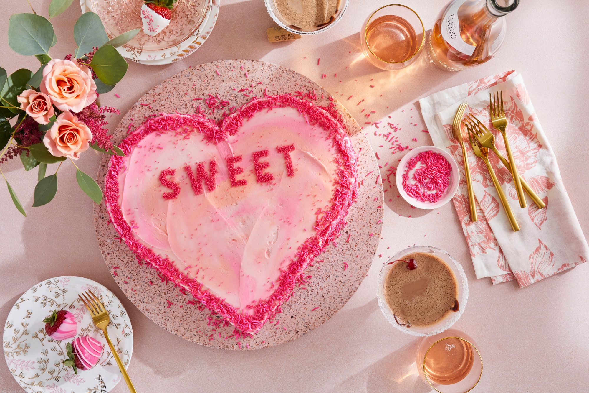 heart shaped cake decorated with pink candy sprinkles for valentine's day