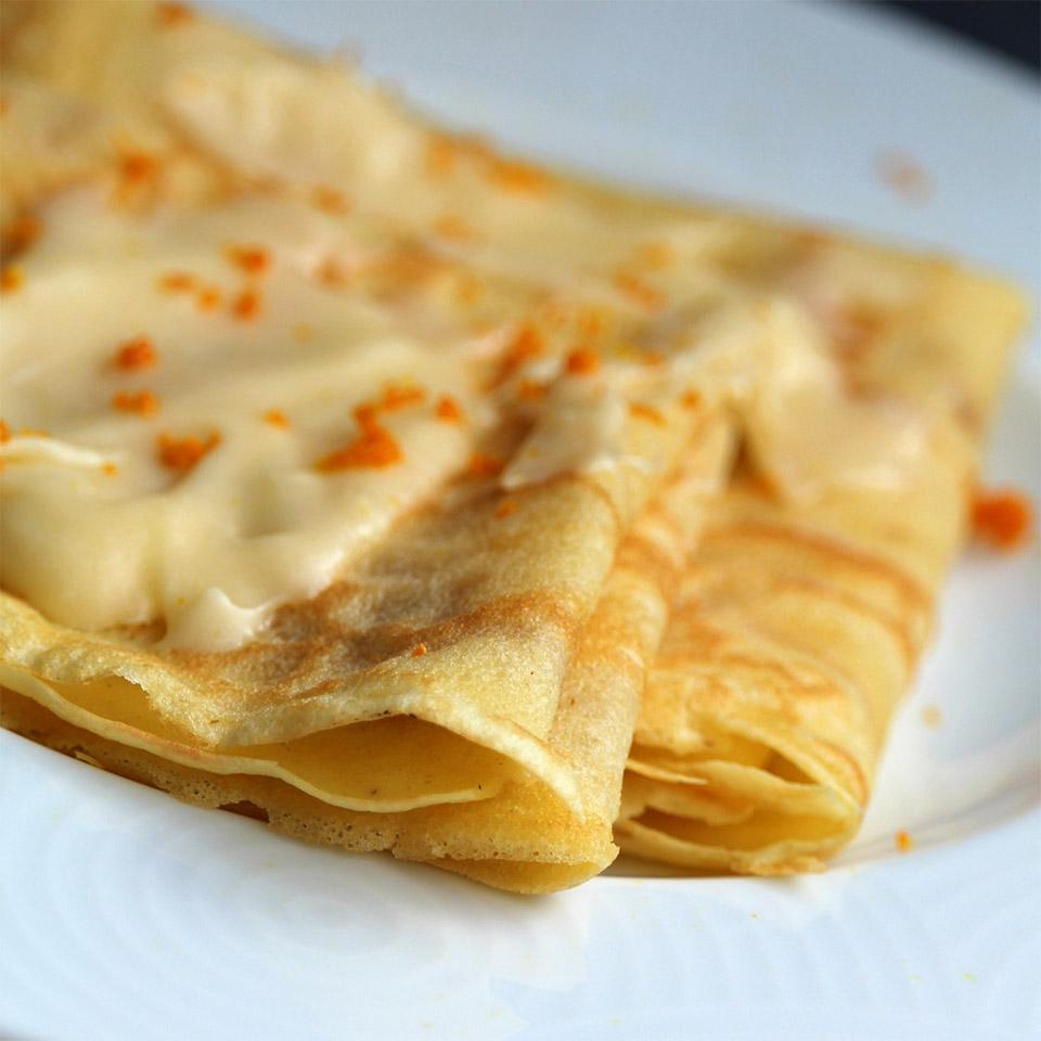 crepes with orange butter and orange zest