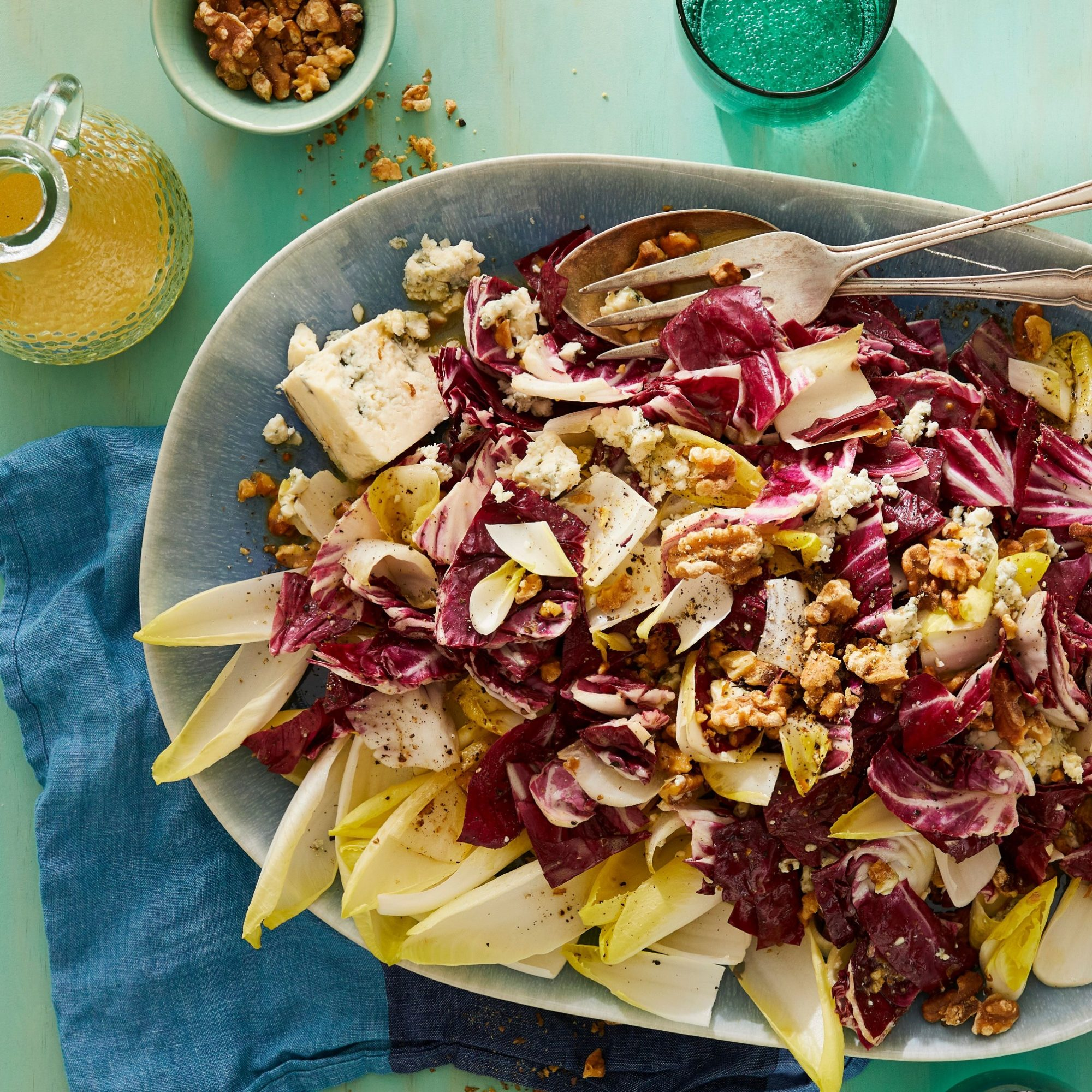 salad of blue cheese, walnuts, endive, and radicchio on a platter