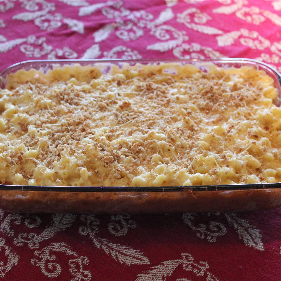 Four-Cheese Truffled Macaroni and Cheese on a red background