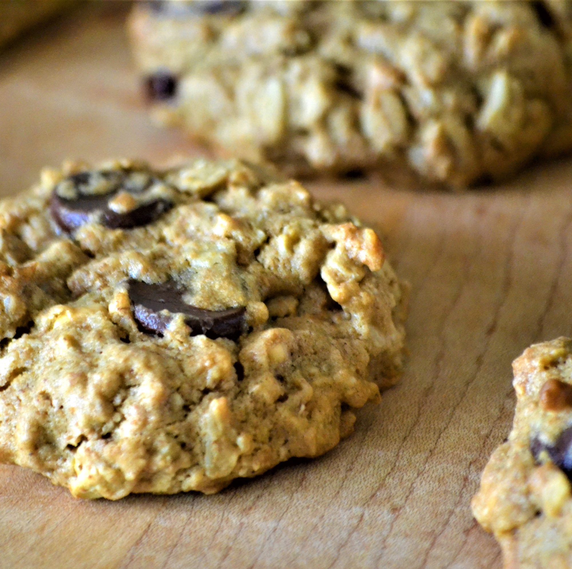 vegan chocolate chip oatmeal and nut cookies on a wooden board closeup