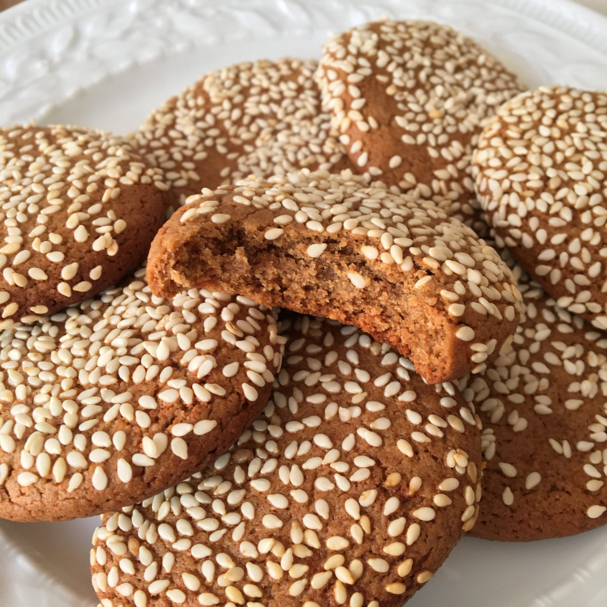 sesame cookies on a white plate